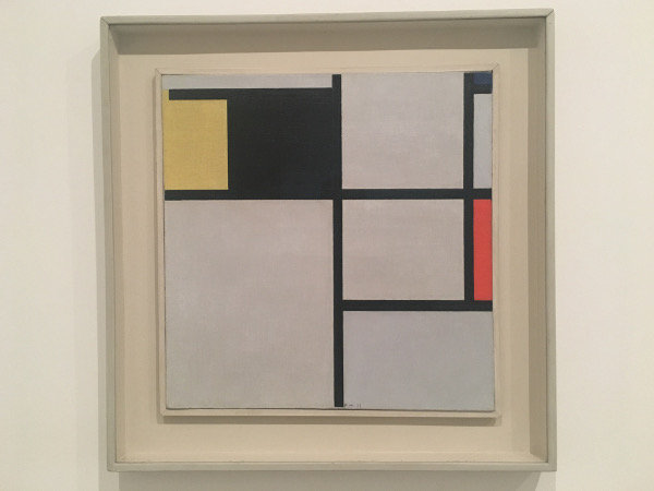 פיט מונדריאן - שולחן עם צהוב, שחור, כחול, אדום ואפור (1923)